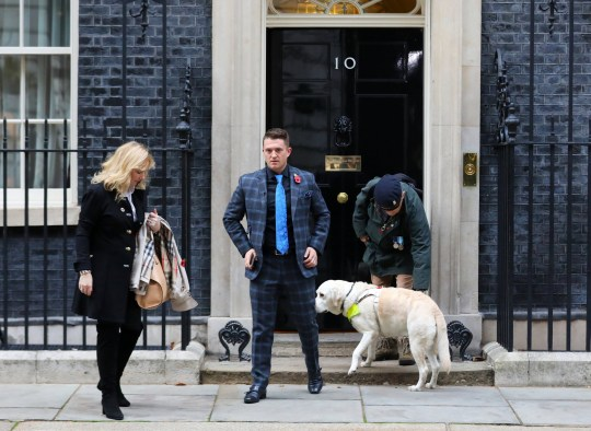 Far right activist Stephen Yaxley-Lennon, who goes by the name Tommy Robinson, walks away from outside 10 Downing Street with MEP Janice Atkinson after handing in a petition on behalf of a serving soldier who was disciplined for posing for a selfie with him, in London, Britain, November 6, 2018. REUTERS/Simon Dawson