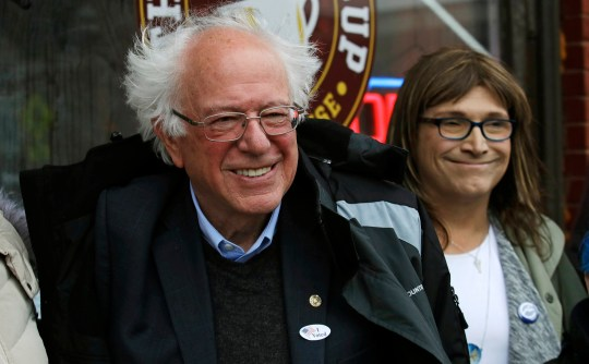 U.S. Sen. Bernie Sanders, I-Vt., left, smiles as he poses for a photograph with Vermont Democratic gubernatorial candidate Christine Hallquist, right, outside City Hall in Saint Albans, Vt., Tuesday, Nov. 6, 2018. (AP Photo/Charles Krupa)