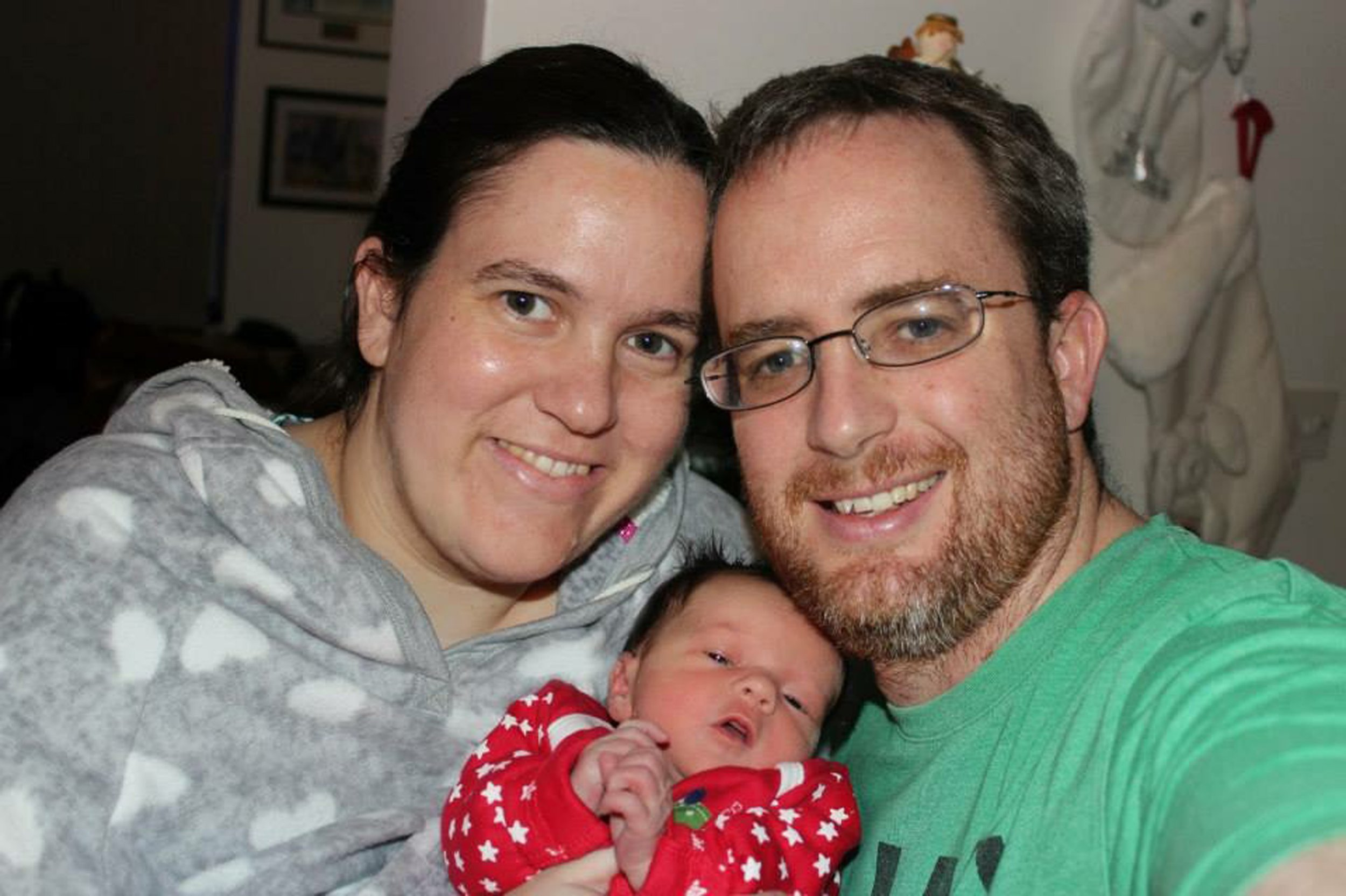 """INS News Agency Ltd. 07/11/2018 File picture - A mother who collapsed and died just weeks after giving birth was told by her doctor she had suffered an anxiety attack and should """"go away and do something fun and come back when you are feeling more relaxed."""" GP Dr Nuala Morton was taken to task by a coroner today (Tues) who criticised her for not keeping notes about her patient's visit to the surgery. The shocking claim that she should go off and enjoy herself despite several collapses and fainting attacks were made at an inquest into the death of 32-year-old Michelle Roach, by her husband George as he gave evidence. Picture shows Michelle Roach with her husband George and baby daughter Mackenzie. See copy INSdoc"""