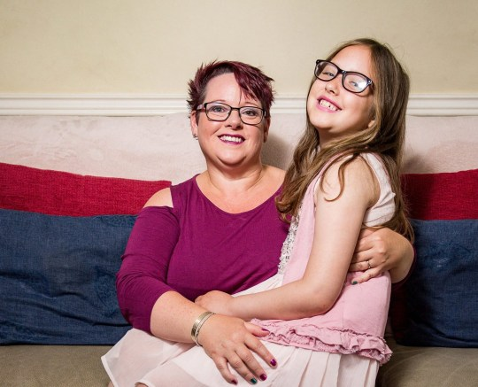 MERCURY PRESS. 08/11/18. Pictured: Sharon Spink, 50, with her nine-year-old daughter Charlotte. A mum has revealed how she will miss her daughter breastfeeding after the youngster finally weaned - aged NINE. Mum-of-four Sharon Spink insisted feeding daughter Charlotte Spink until earlier this year was completely normal and has cemented a lifelong bond between them. She said despite doing it for almost a decade she is happy the schoolgirl made her own decision to stop two months ago. SEE MERCURY COPY