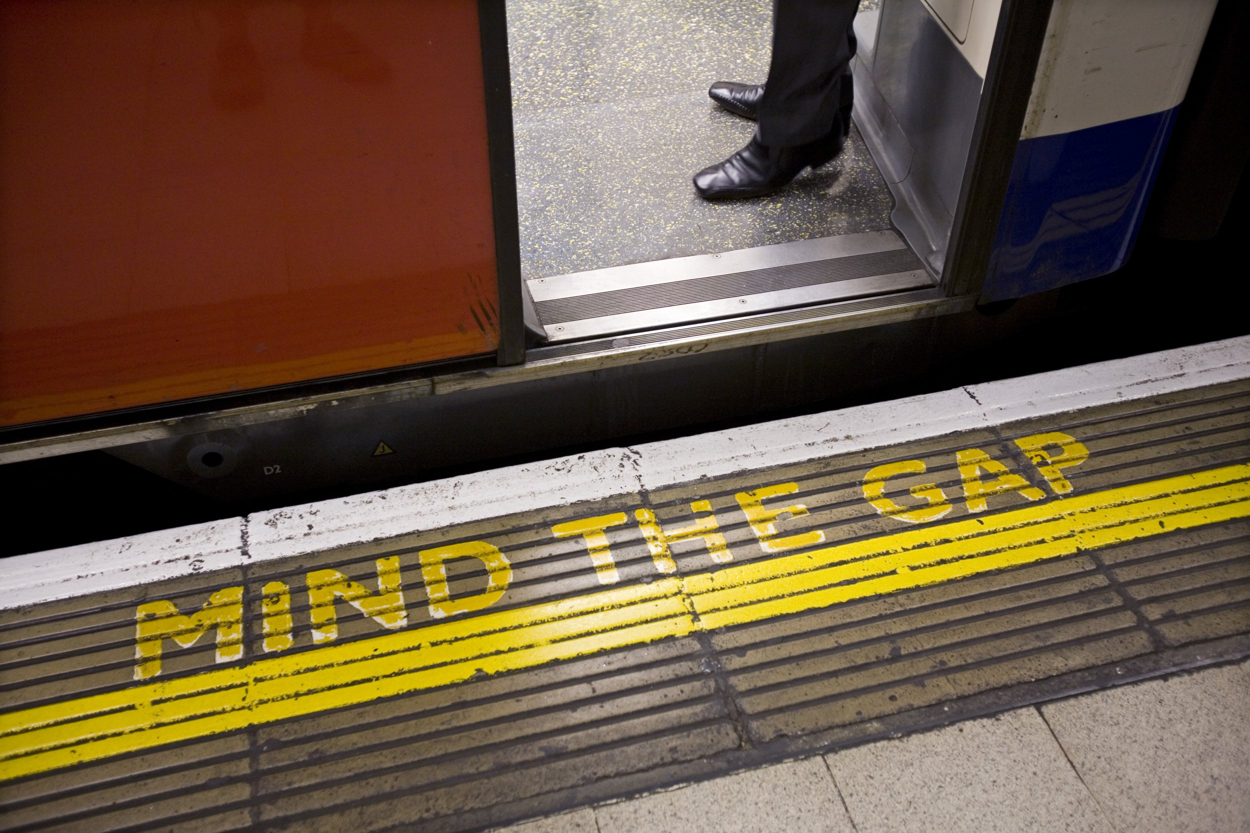 A classic Mind the Gap painted sign on a London Underground platform. (Photo by In Pictures Ltd./Corbis via Getty Images)