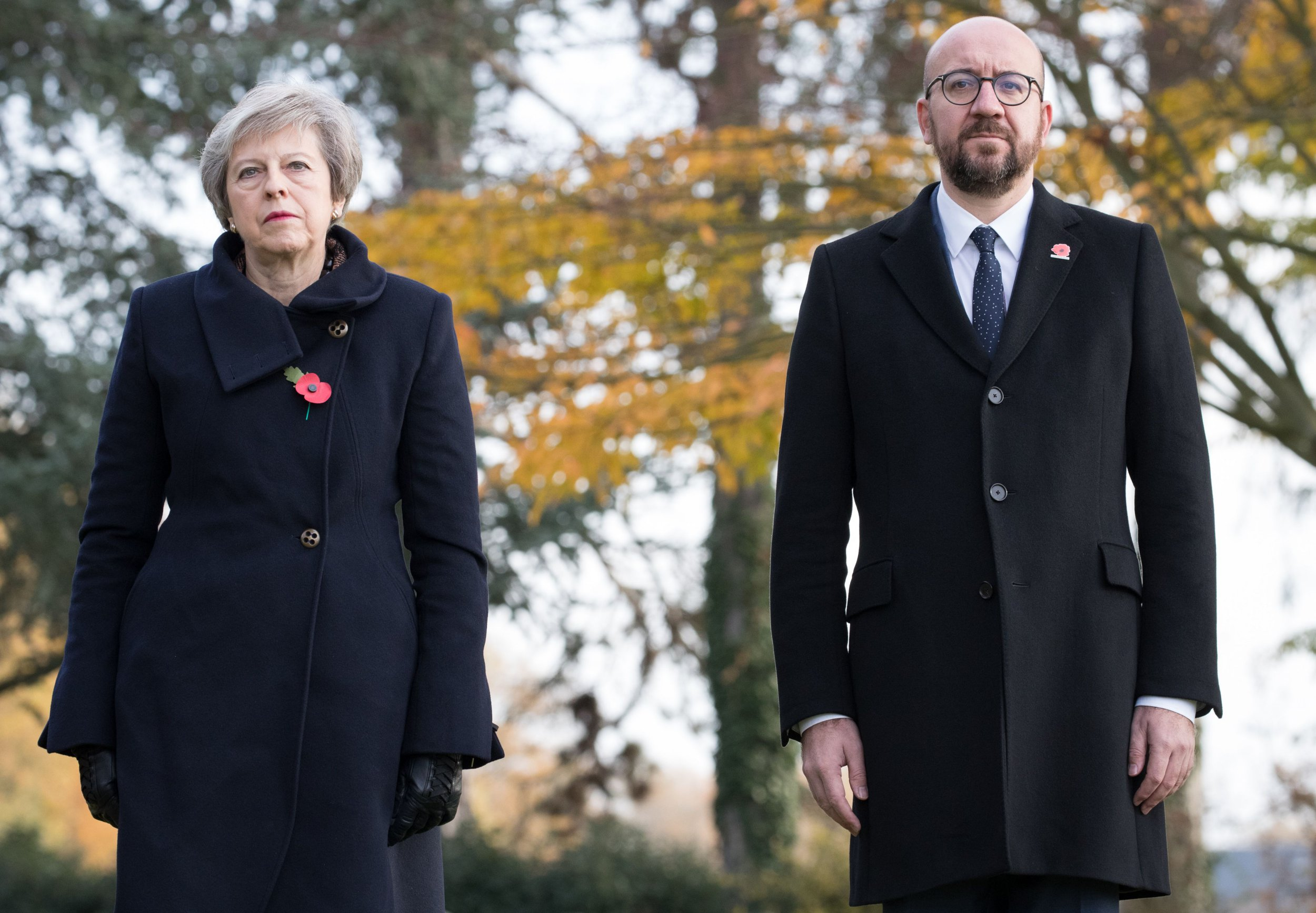 Britain's Prime Minister Theresa May (L) and Belgium's Prime Minister Charles Michel stand during the commemoration of the 100th anniversary of the end of the First World War at the Saint-Symphorien Military Cemetery, near Mons, on November 9, 2018. (Photo by BENOIT DOPPAGNE / Belga / AFP) / Belgium OUTBENOIT DOPPAGNE/AFP/Getty Images