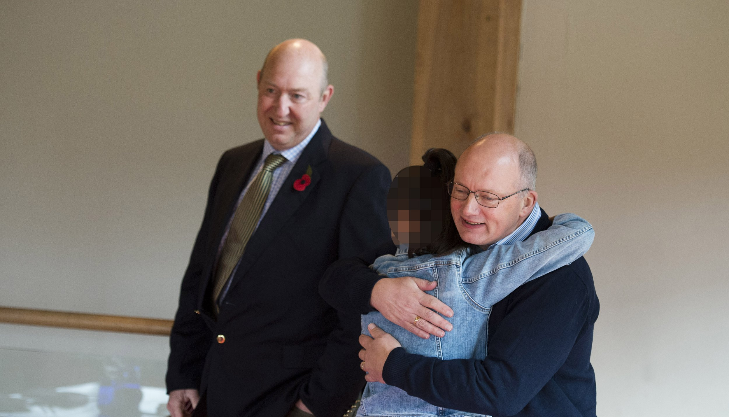 Online usage fee ?75 per image. Print fee ?150. Embargoed until 12pm on 10.11.18 Victim of Paedophile Craig Sweeney and her mother (who cannot be identified) pictured meeting the two police officers who rescued her as a 3 year old. Marcus Beresford-Smith (jacket) and Richard Moorhouse rescued the victim and arrested Sweeney after a high speed car chase in 2006.