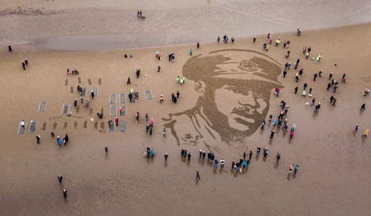 A sand drawing on Ayr Beach of Second Lieutenant Walter Tull, who was Britain?s second black professional footballer who had signed up with Rangers, and the first black officer in the British Army. Pages of the Sea: Danny Boyle?s Armistice commission for 14-18 NOW and National Theatre of Scotland. Nov 11 2018