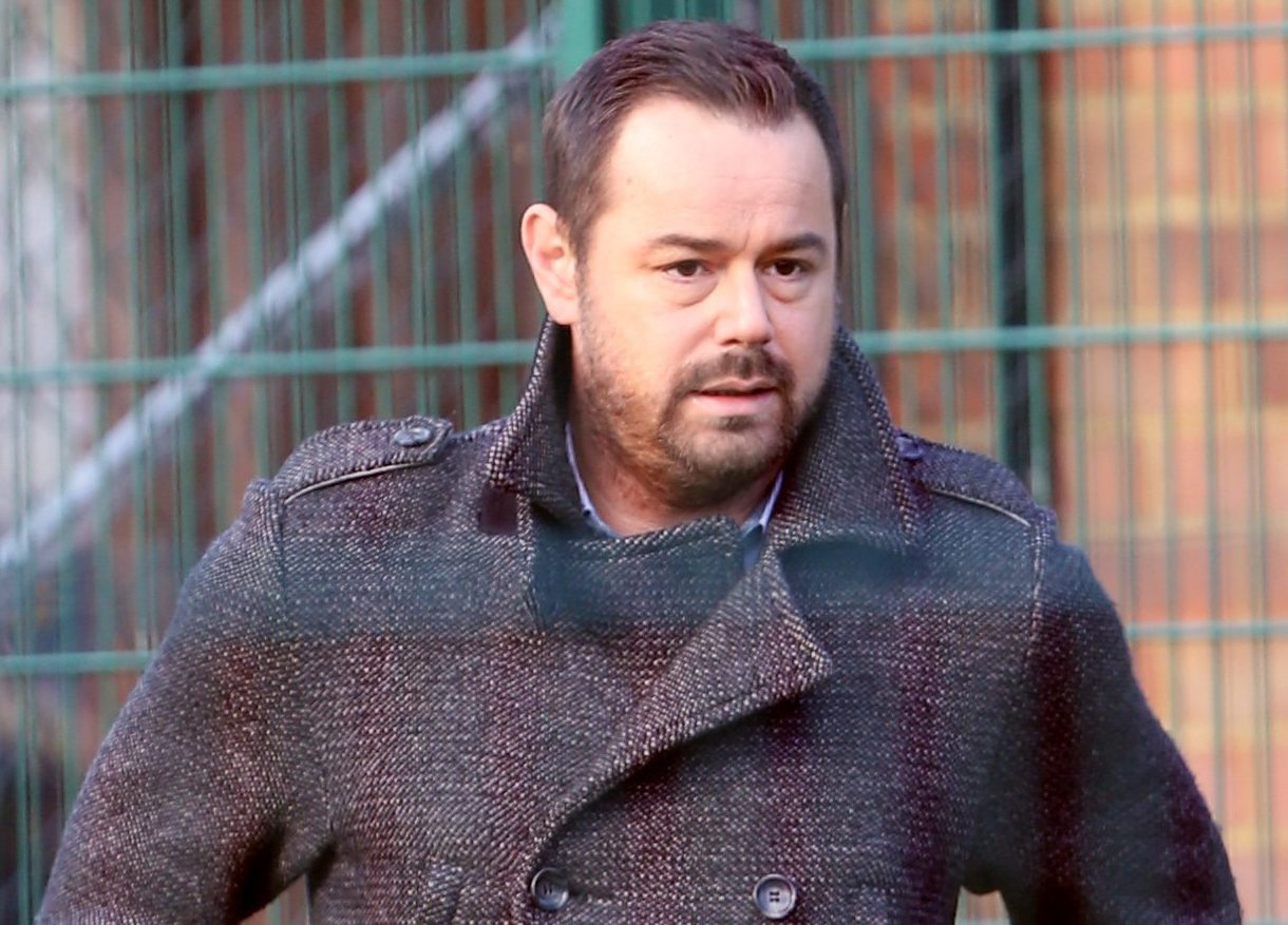 EXC ALL ROUND EASTENDERS SPOILER DANNY DYER WITH SMASHED UP KNUCKLES AND ZACK MORRIS WHO PLAYS TROUBLED TEENAGER KEEGAN TAYLOR SPOTTED HELPING OUT AT WALFORD WANDERERS FC TRAINING CENTRE BUT THEY ARE SHOWN A LESSON IN FOOTBALL BY ONE OF THE KIDS MOTHERS WHO IS SHOWN RUNNING RINGS ROUND THEM AND PASSING THE BALL THROUGH DYERS LEGS AND MADE DYER LOOK SILLY ! BYLINE TO READ: ISO IMAGES