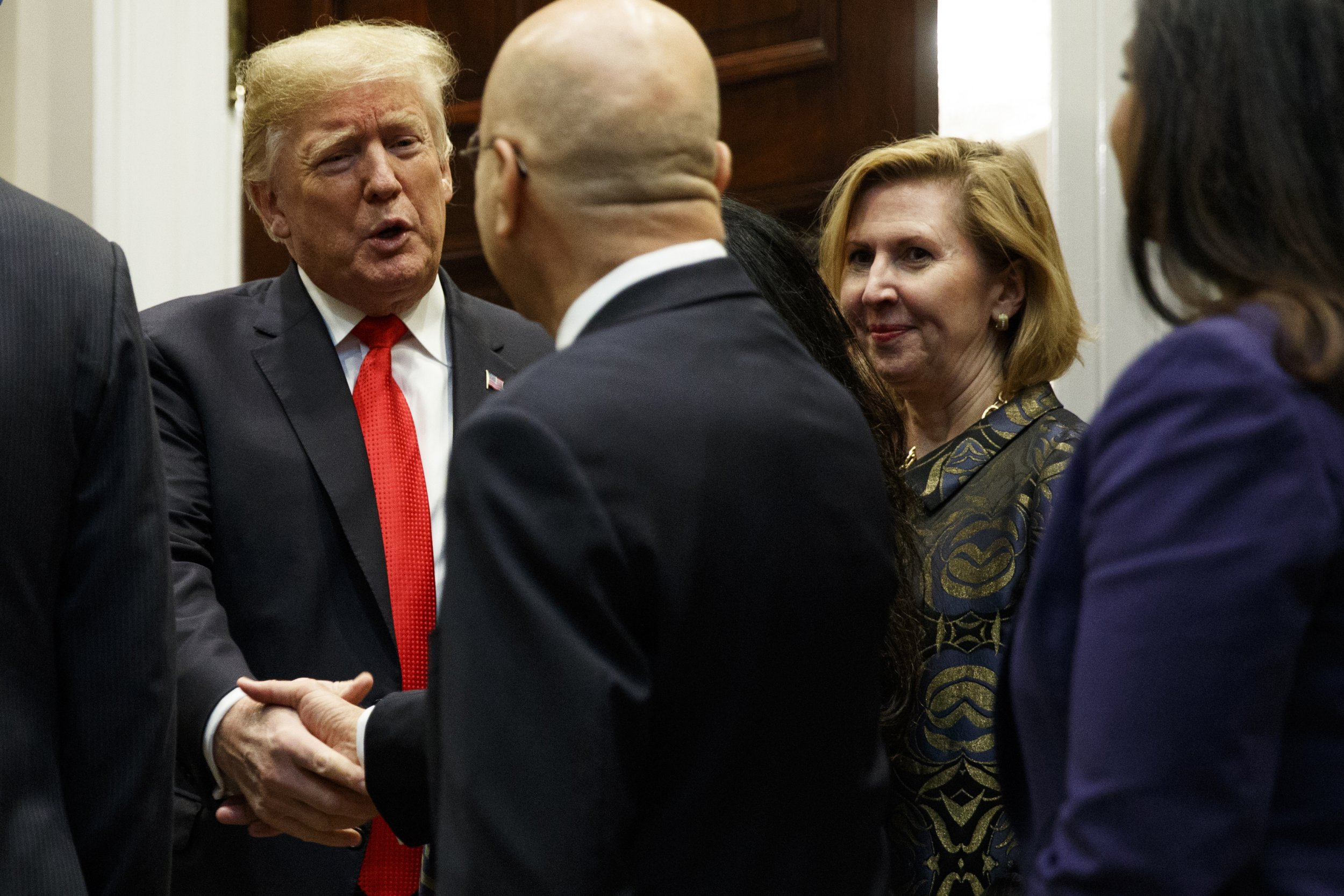 Deputy National Security Adviser Mira Ricardel, right, watches as President Donald Trump arrives for a Diwali ceremonial lighting of the Diya in the Roosevelt Room of the White House, Tuesday, Nov. 13, 2018, in Washington. In an extraordinary move, first lady Melania Trump is publicly calling for the dismissal of Ricardel. After reports circulated that the president had decided to remove Ricardel, the first lady???s spokeswoman issued a statement saying: ???It is the position of the Office of the First Lady that she no longer deserves the honor of serving in this White House.??? Ricardel is national security adviser John Bolton???s deputy. (AP Photo/Evan Vucci)