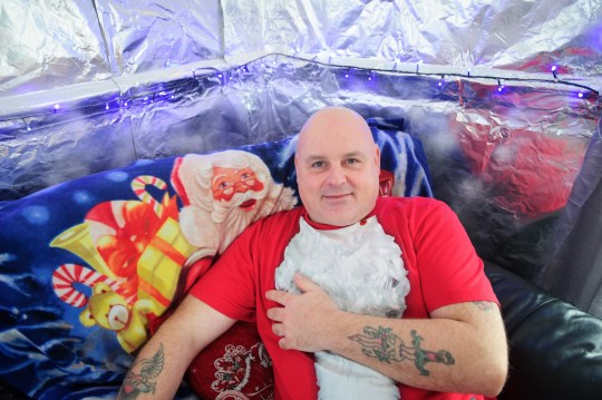 A penny-pinching dad has foiled his Christmas spending - by decorating his house with a ton of Bacofoil. Carl Jones, 47, decked the walls and ceilings of the family's lounge with ??20 of foil last year to save on tinsel and spray snow, much to the horror of his wife Lesley. And this year he has saved even more - because aluminium foil company Bacofoil gave him a ton of free foil wraps. PIC: Mark Lewis WALES NEWS SERVICE