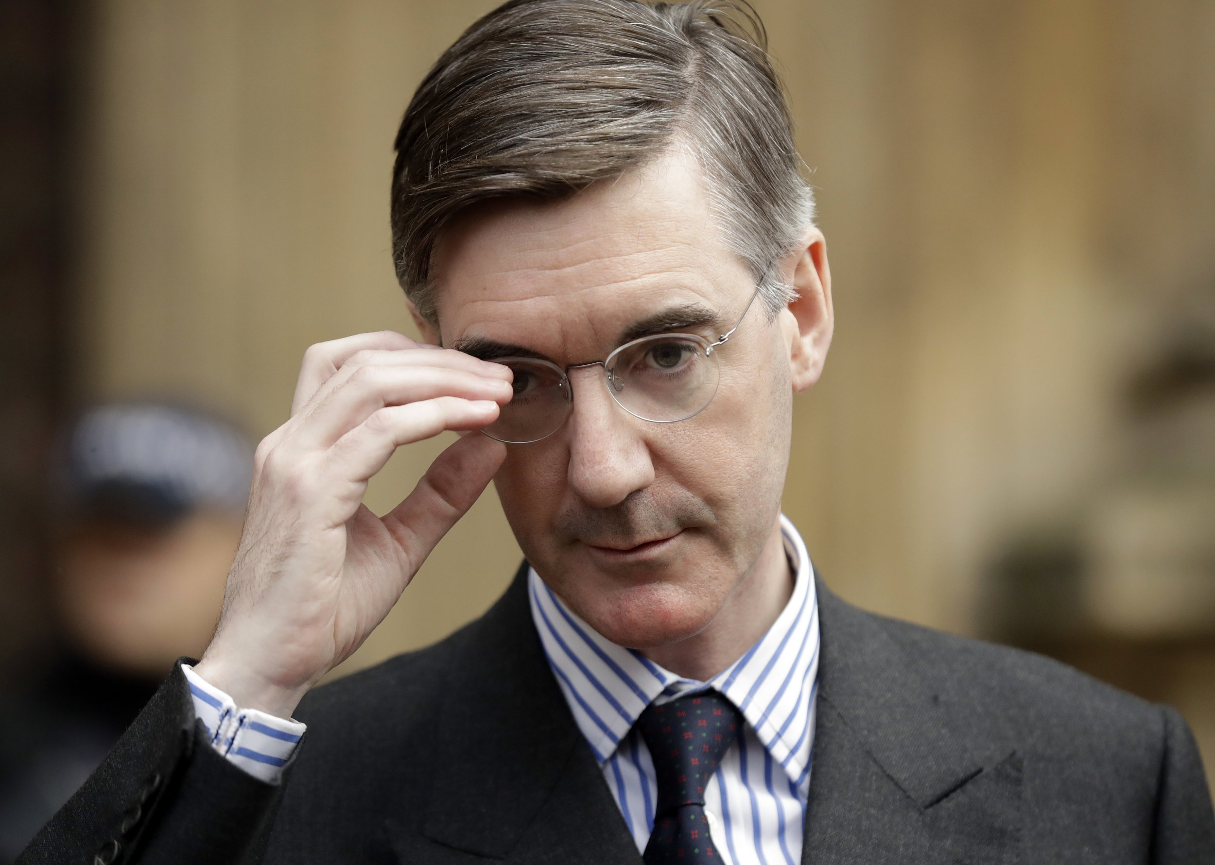 Pro-Brexit, Conservative lawmaker Jacob Rees-Mogg adjusts his glasses as he speaks to the media outside the Houses of Parliament in London, Thursday, Nov. 15, 2018. A pro-Brexit group of Conservative lawmakers says one of its leaders, Jacob Rees-Mogg, is formally calling for a vote of no-confidence in Prime Minister Theresa May. Two British Cabinet ministers, including Brexit Secretary Dominic Raab, resigned Thursday in opposition to the divorce deal struck by Prime Minister Theresa May with the EU ??? a major blow to her authority and her ability to get the deal through Parliament.(AP Photo/Matt Dunham)