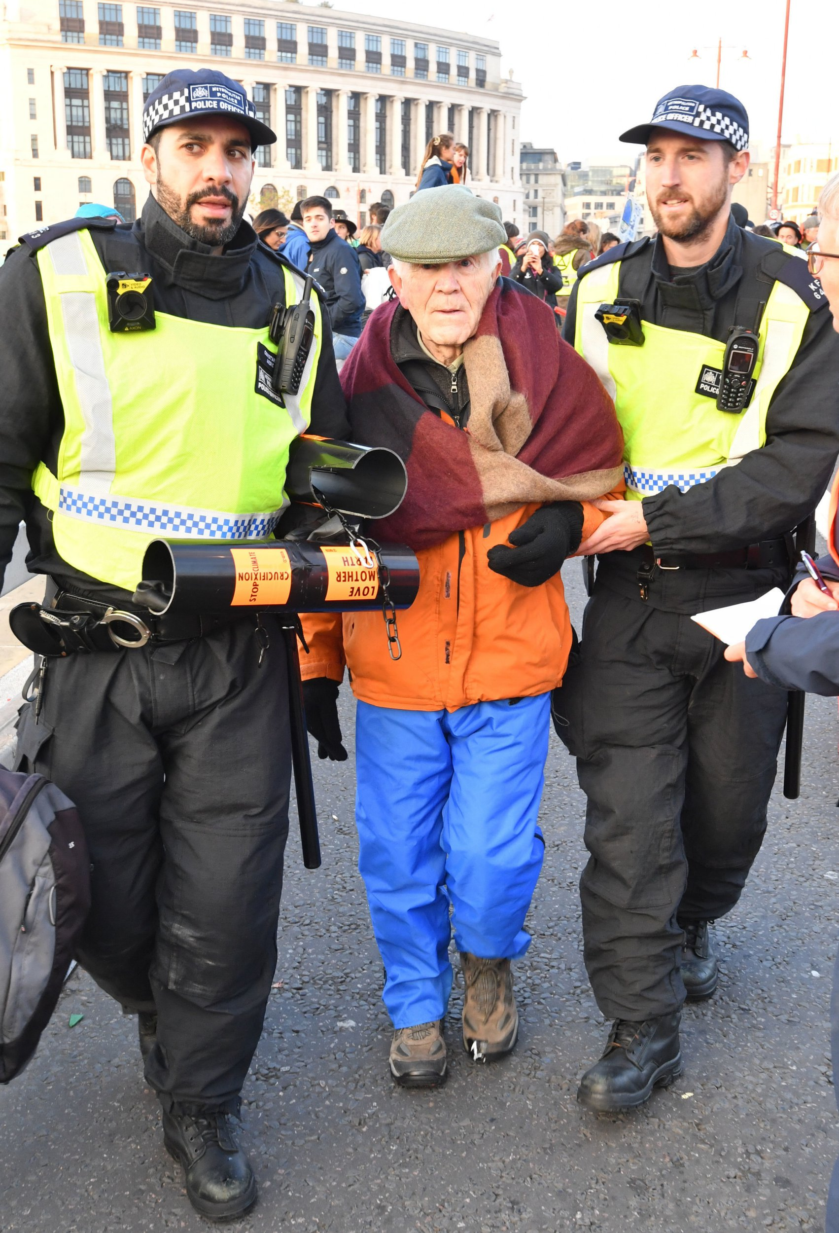 A demonstrator is led away by police on Blackfriars Bridge in London during a protest called by Extinction Rebellion to raise awareness of the dangers posed by climate change. PRESS ASSOCIATION Photo. Picture date: Saturday November 17, 2018. See PA story PROTEST Rebellion. Photo credit should read: John Stillwell/PA Wire