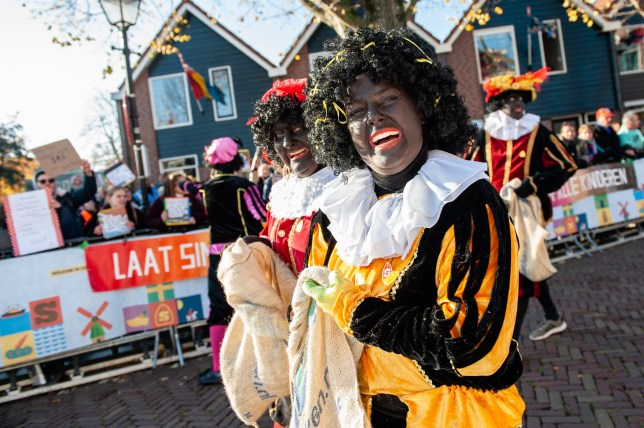 The red-and-white-clad Sinterklaas (St. Nicholas) is a Christmas tradition in the Netherlands but has been removed from Facebook because it violates new guidelines on blackface (Photo by Romy Arroyo Fernandez/NurPhoto/Sipa USA)