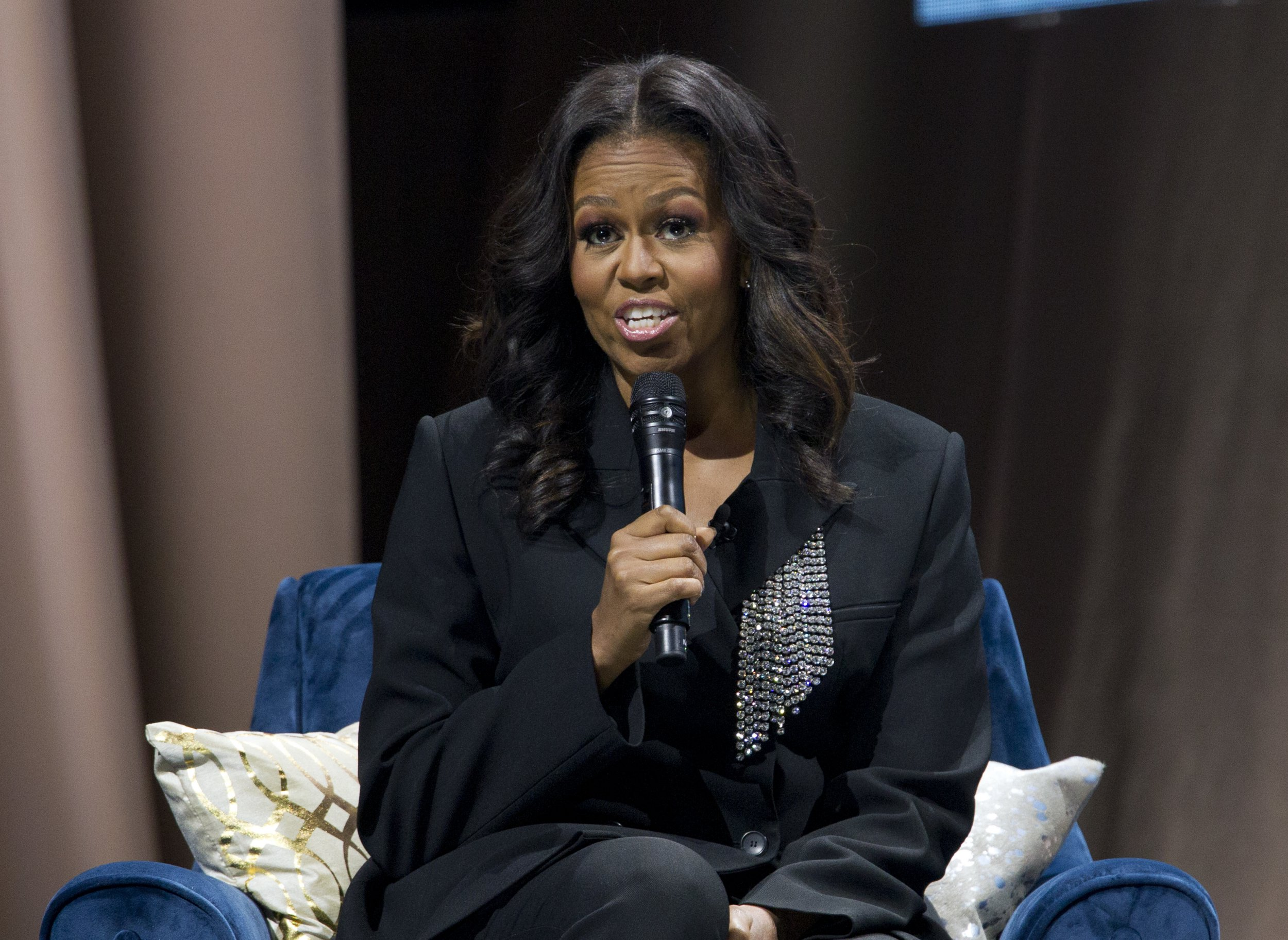 "Former first lady Michelle Obama speaks to the crowd as she presents her anticipated memoir ""Becoming"" during her book tour stop in Washington, Saturday, Nov. 17, 2018. (AP Photo/Jose Luis Magana)"