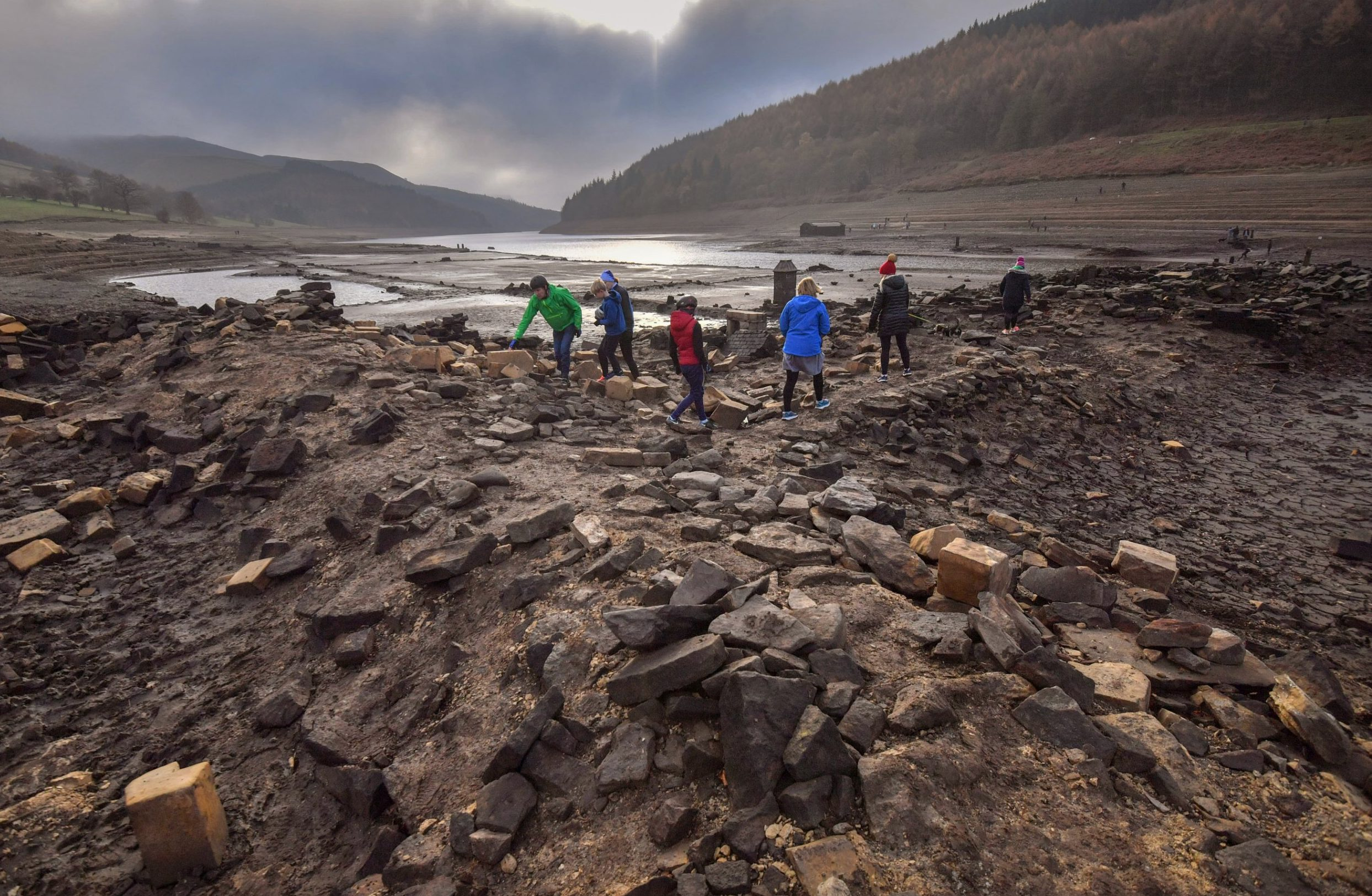 SHEFFIELD, ENGLAND - NOVEMBER 18: The ruins of Derwent Hall are exposed by low water levels in Ladybower reservoir on November 18, 2018 in Sheffield, England. The villages of Derwent and Ashopton in Derbyshire were deliberately flooded in 1943 to create Ladybower and Derwent reservoir, famously used by the Dambusters for practice missions during the Second World War. (Photo by Anthony Devlin/Getty Images)