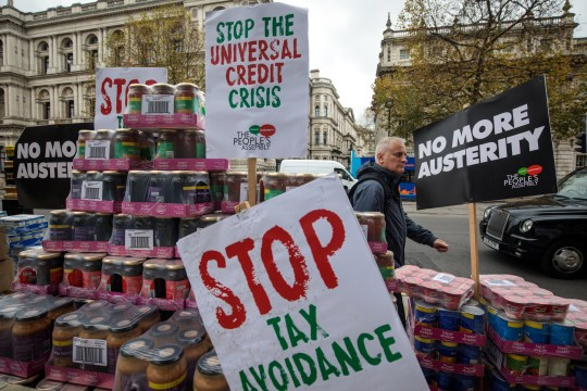 LONDON, ENGLAND - NOVEMBER 21: A protester stages a food bank demonstration on Whitehall complete with tons of packaged food against the Government's Universal Credit programme on November 21, 2017 in London, England. The campaign group the People's Assembly Against Austerity are staging a number of protests across the country ahead of tomorrow's Budget. (Photo by Jack Taylor/Getty Images)