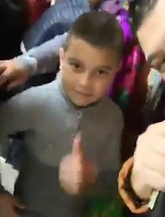 "Pic shows: In the video, the singer calls on the groom and tells him to: ""leave the toys aside, today you've married your bride"" A singer has caused controversy by live streaming himself singing at the gypsy wedding of an eight-year-old girl to a 10-year-old boy. The bizarre incident occurred at a wedding in the city of Craiova, South-western Romania???s Dolj County where the singer, named as Alex de la Caracal, was asked to perform. In the video, the singer can be seen performing as a crowd gathers around the bride, reportedly eight years old, and they can be seen putting the finishing touches on her outfit. The groom, reportedly 10 years old, can be seen dancing along to Alex???s folk music. The bride???s pink dress is comically oversized and seems more suited to an adult woman rather than a young girl. The singer continues performing with a smile on is face throughout the video. Marriages between minors are illegal in Romania and self-proclaimed Roma community leader, Dorin Cioaba, announced four years ago that the gypsies who marry their underage children would be handed to the police. There has been no reaction from the Gypsy community or from the authorities regarding the incident. Netizen 'DonVochin' claimed that the event in the video was not a real wedding but a ritual ceremony in which the two children agree that they are promised to each other. The social media user says the official wedding will take place when the youngsters are older. In 2011, a similar event took place in the county of Galati, in the eastern Romanian region of Moldavia. The 'couple' getting married then were aged 8 and 7 and the 'wedding' attracted the attention of the authorities. After an investigation, the authorities said that there was no action to be taken as the 'marriage' was not legally registered at the town hall."