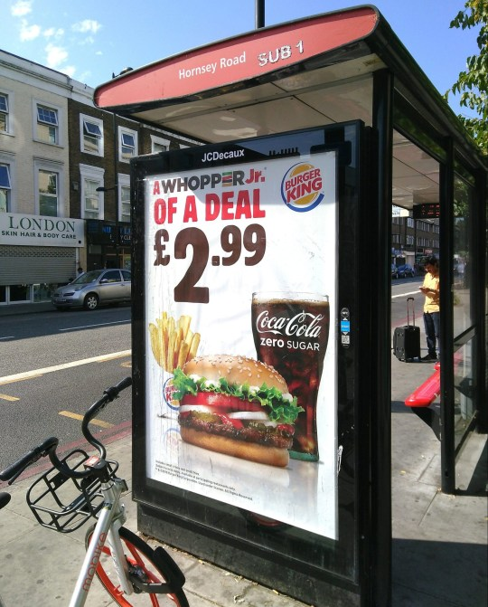 EMBARGOED TO 0001 WEDNESDAY NOVEMBER 21 Undated handout photo issued by the Advertising Standards Authority (ASA) of a poster ad on a bus stop, for Burger King?s Whopper Jr ?2.99 meal deal, as adverts for Burger King and McDonald?s have been banned after they were placed less than 100 metres from the gates of primary schools. PRESS ASSOCIATION Photo. Issue date: Wednesday November 21, 2018. The poster features an image of the whopper burger, fries and a zero sugar Coca Cola and appeared at a bus stop 96 metres away from a school. See PA story CONSUMER HFSS. Photo credit should read: ASA/PA Wire NOTE TO EDITORS: This handout photo may only be used in for editorial reporting purposes for the contemporaneous illustration of events, things or the people in the image or facts mentioned in the caption. Reuse of the picture may require further permission from the copyright holder.