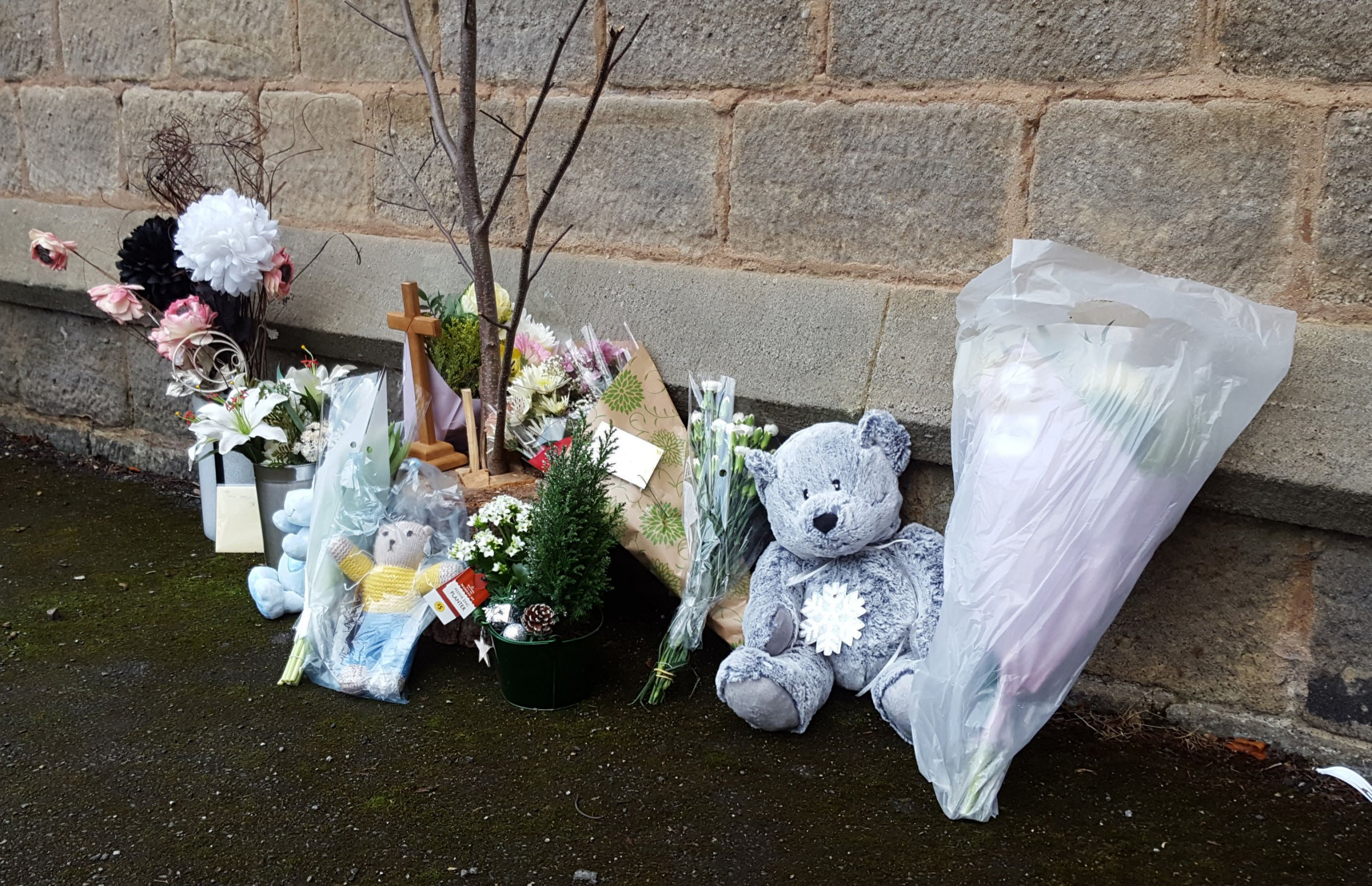 Tributes left at St Peters Church, Bramley, Leeds, where a newborn baby was found and pronounced dead soon after .