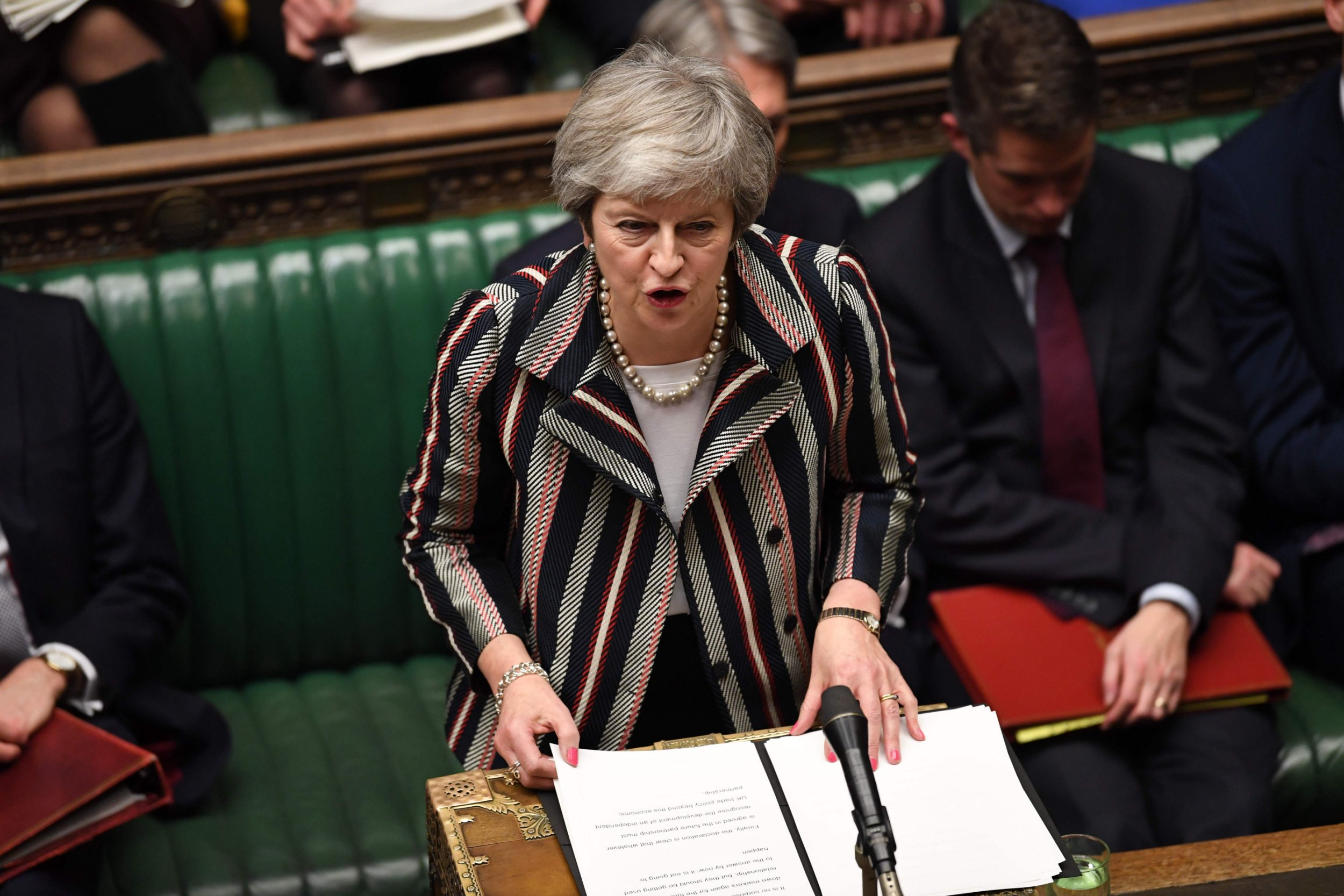 """A handout photograph released by the UK Parliament shows Britain's Prime Minister Theresa May giving a statement to the House of Commons in London on November 26, 2018, to update parliament on the newly-agreed Brexit deal. - Theresa May will convene her cabinet and update parliament on the newly-agreed Brexit deal on Monday, as the embattled British prime minister begins the tricky mission of selling the plan to a sceptical country. (Photo by Jessica TAYLOR / UK PARLIAMENT / AFP) / RESTRICTED TO EDITORIAL USE - NO USE FOR ENTERTAINMENT, SATIRICAL, ADVERTISING PURPOSES - MANDATORY CREDIT """" AFP PHOTO / Jessica Taylor /UK Parliament""""JESSICA TAYLOR/AFP/Getty Images"""