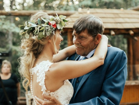 Bride Vanessa Wickham,24, dances with her terminally-ill father Lew Johnston,65, at her wedding in Lake Arrowhead, California..See SWNS story SWNYbride.This is the emotional moment a bride danced with her terminally-ill dad on her wedding day after fearing he would be too sick to walk her down the aisle. Vanessa Wickham, 24, worried Lew Johnston, 65, would be unable to attend as he is in the end stages of chronic obstructive pulmonary disease.Lew was diagnosed with the degenerative illness, which obstructs airflow to the lungs, 20 years ago and now needs 24/7 oxygen to keep him alive. Vanessa and groom Mike Wickham, 25, feared he would struggle to breathe at their venue in Lake Arrowhead, California, as it is 4,000ft above sea level.