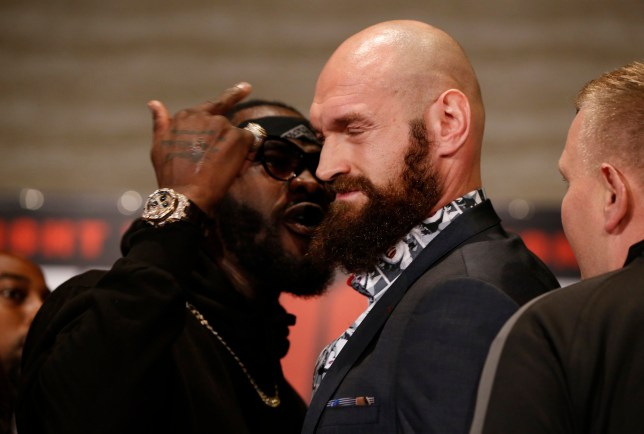 Boxers Deontay Wilder, left, and Tyson Fury exchange words as they face each other at a news conference in Los Angeles, Wednesday, Nov. 28, 2018. The pair are slated to fight Saturday night for Wilder's WBC heavyweight title. (AP Photo/Damian Dovarganes)