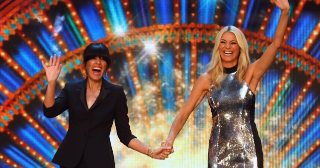Claudio Winkleman and Tess Daly hold hands on Strictly Come Dancing set.