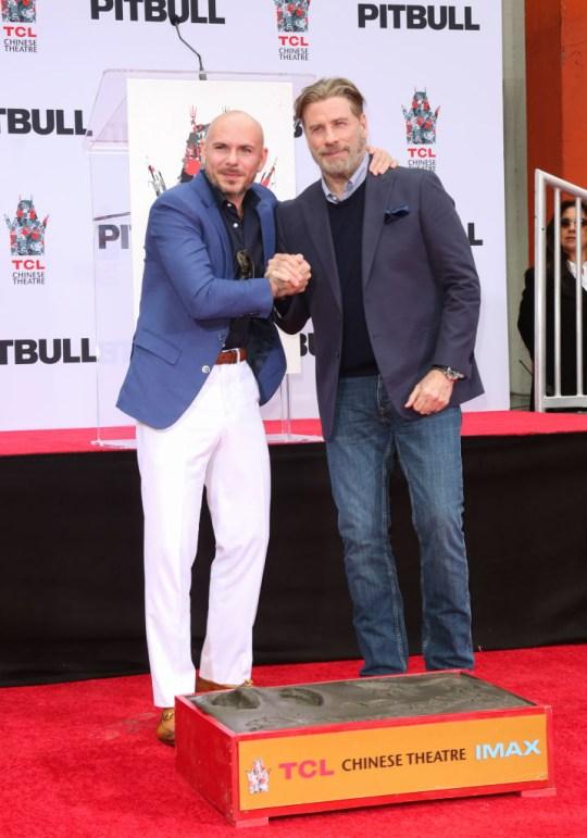 John Travolta declares Pitbull one of the 'greatest