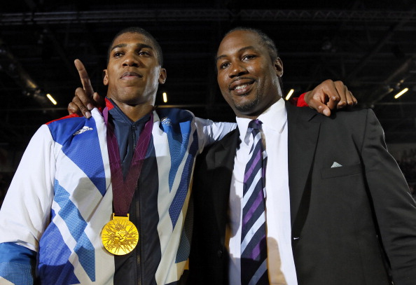 Lennox Lewis slams 'too happy' Anthony Joshua for ducking Deontay Wilder and Tyson Fury