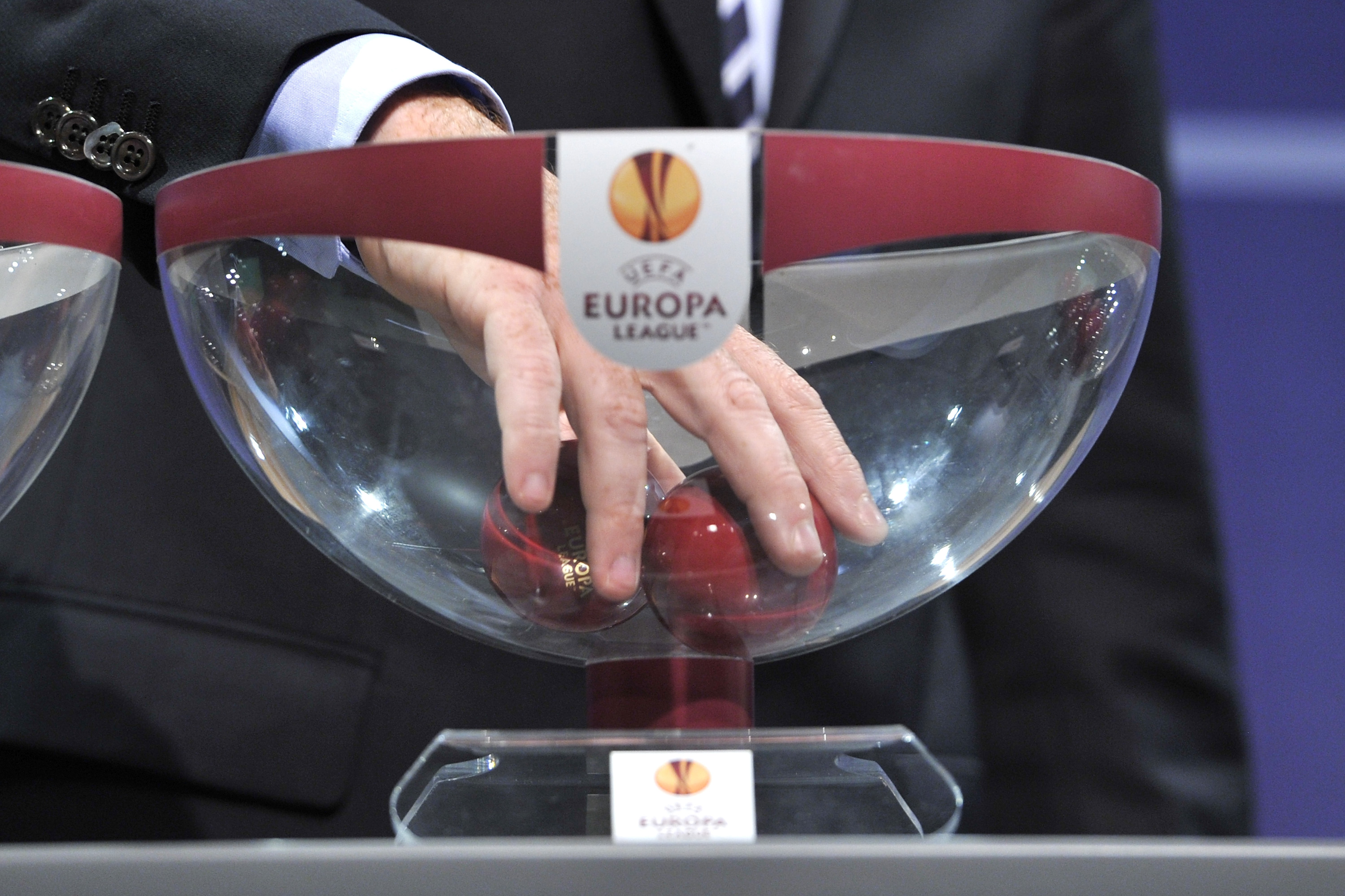 When is the draw for the Europa League last 16 and who can Arsenal and Chelsea face?