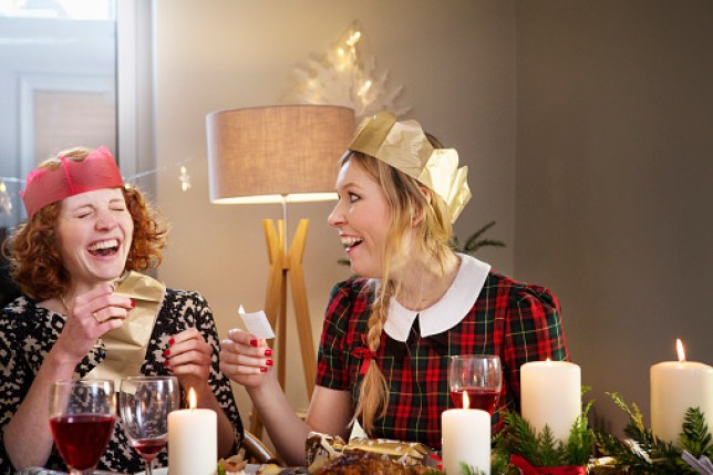 Women sitting around Christmas Dinner table