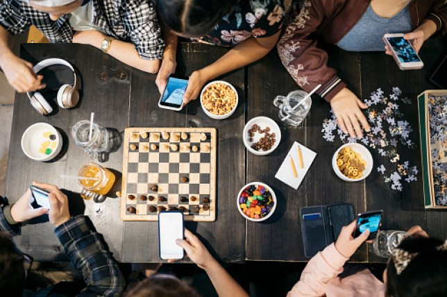 Top-down view of people playing board games