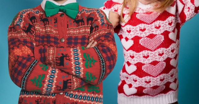 Two people wearing Christmas jumpers