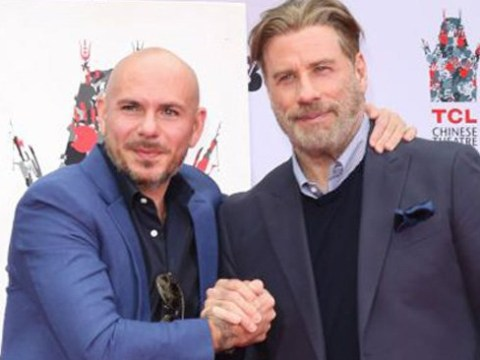 John Travolta declares Pitbull one of the 'greatest entertainers' ever in the most adoring speech