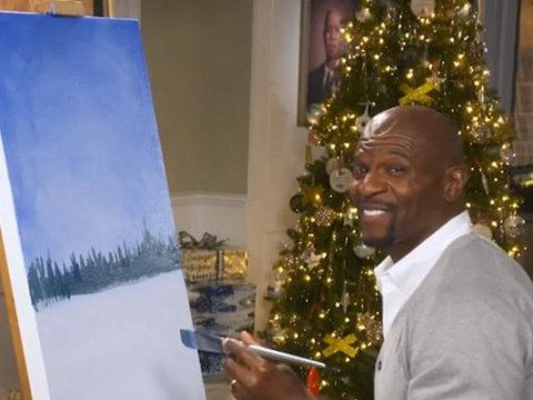 Terry Crews painting in front of a crackling fire is all you need this Christmas