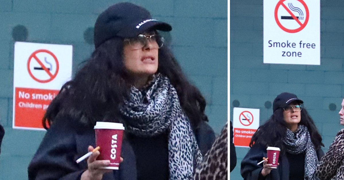Salma Hayek clearly doesn't follow instructions especially signs that clearly state 'No Smoking' at Heathrow Airport