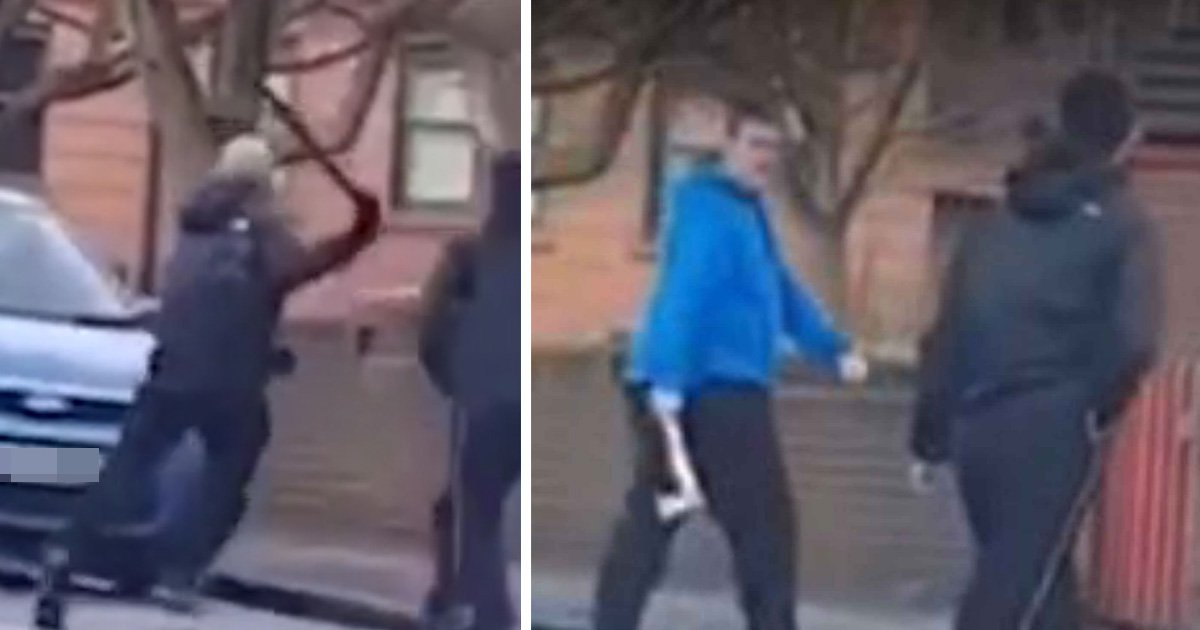 Vigilante armed with an axe confronts gang in the street