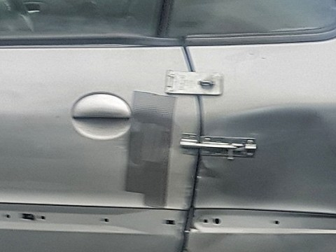 Driver installs bolts and padlocks on his car door just like Mr Bean