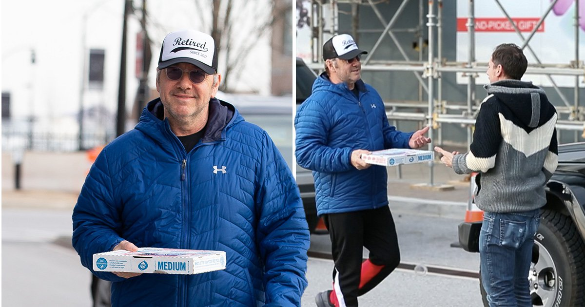 Kevin Spacey wears 'retired since 2017' cap as he delivers pizza to waiting paparazzi