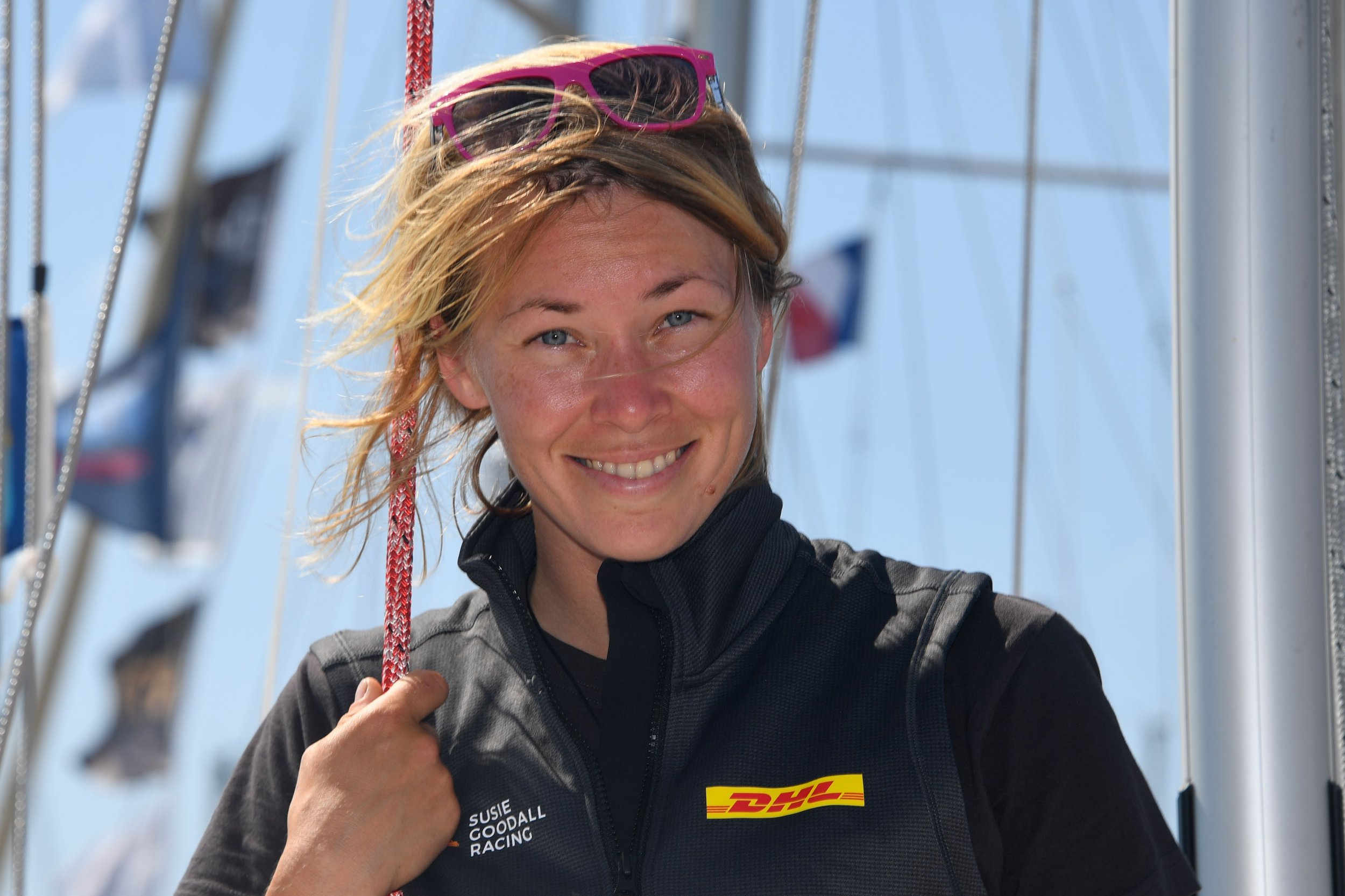 "British Susie Goodall poses on her boat ""DHL Starlight"" in Les Sables d'Olonne Harbour, on June 29, 2018, ahead of the solo around-the-world sailing race for the ""Golden Globe Race"" ocean race in which sailors compete without high technology aides such as GPS or computers. (Photo by Damien MEYER / AFP) (Photo credit should read DAMIEN MEYER/AFP/Getty Images)"