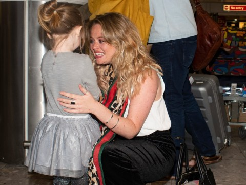 I'm A Celebrity runner-up Emily Atack breaks down in tears during emotional family reunion at Heathrow Airport
