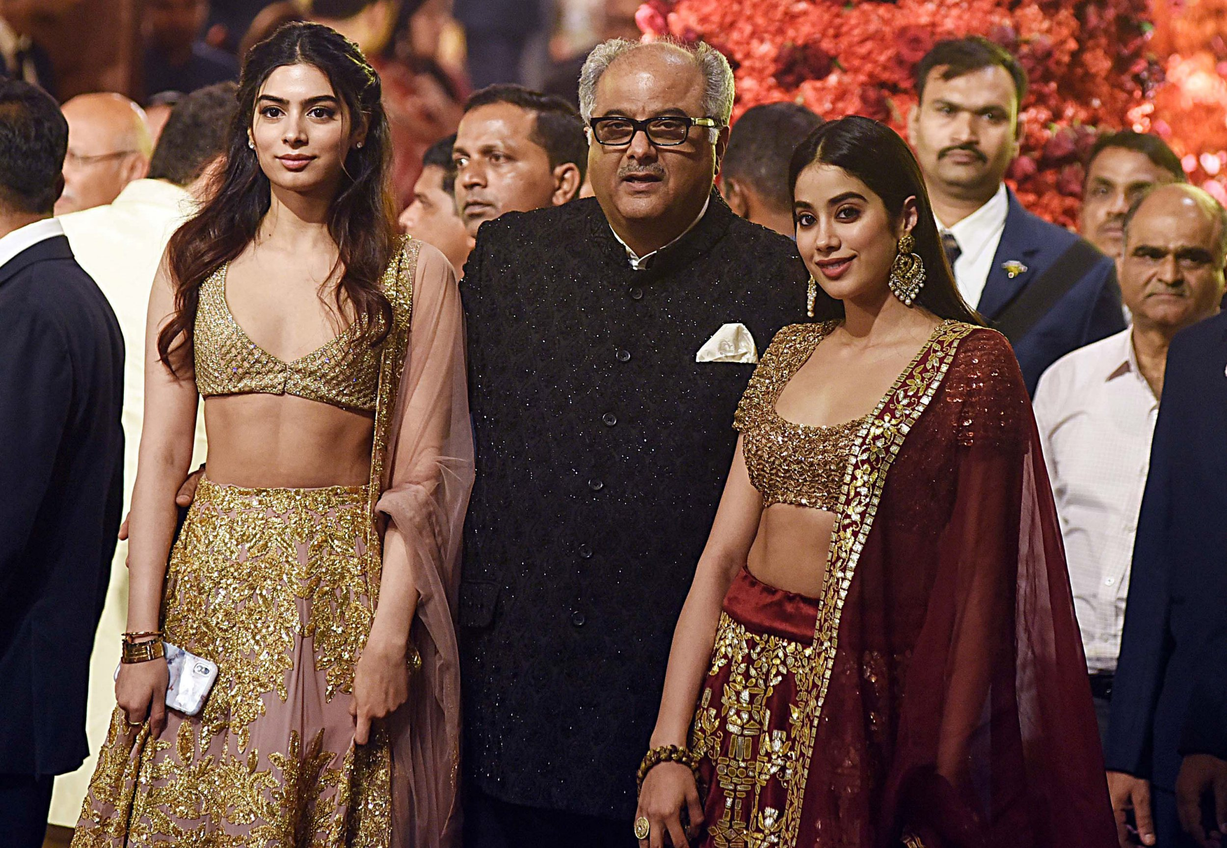 Indian Bollywood film producer Boney Kapoor (C) with his daughters, actresses Khushi (L) and Janhvi Kapoor (R), attend the wedding of Indian businesswoman Isha Ambani with Indian businessman Anand Piramal in Mumbai on December 12, 2018. - Isha Ambani, whose father is tycoon Mukesh Ambani, wedded Anand Piramal, son of Indian billionaire industrialist Ajay Piramal, in the Ambanis' 27-storey home in Mumbai. (Photo by - / AFP)-/AFP/Getty Images