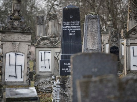Jewish graves daubed with swastikas in racist attack