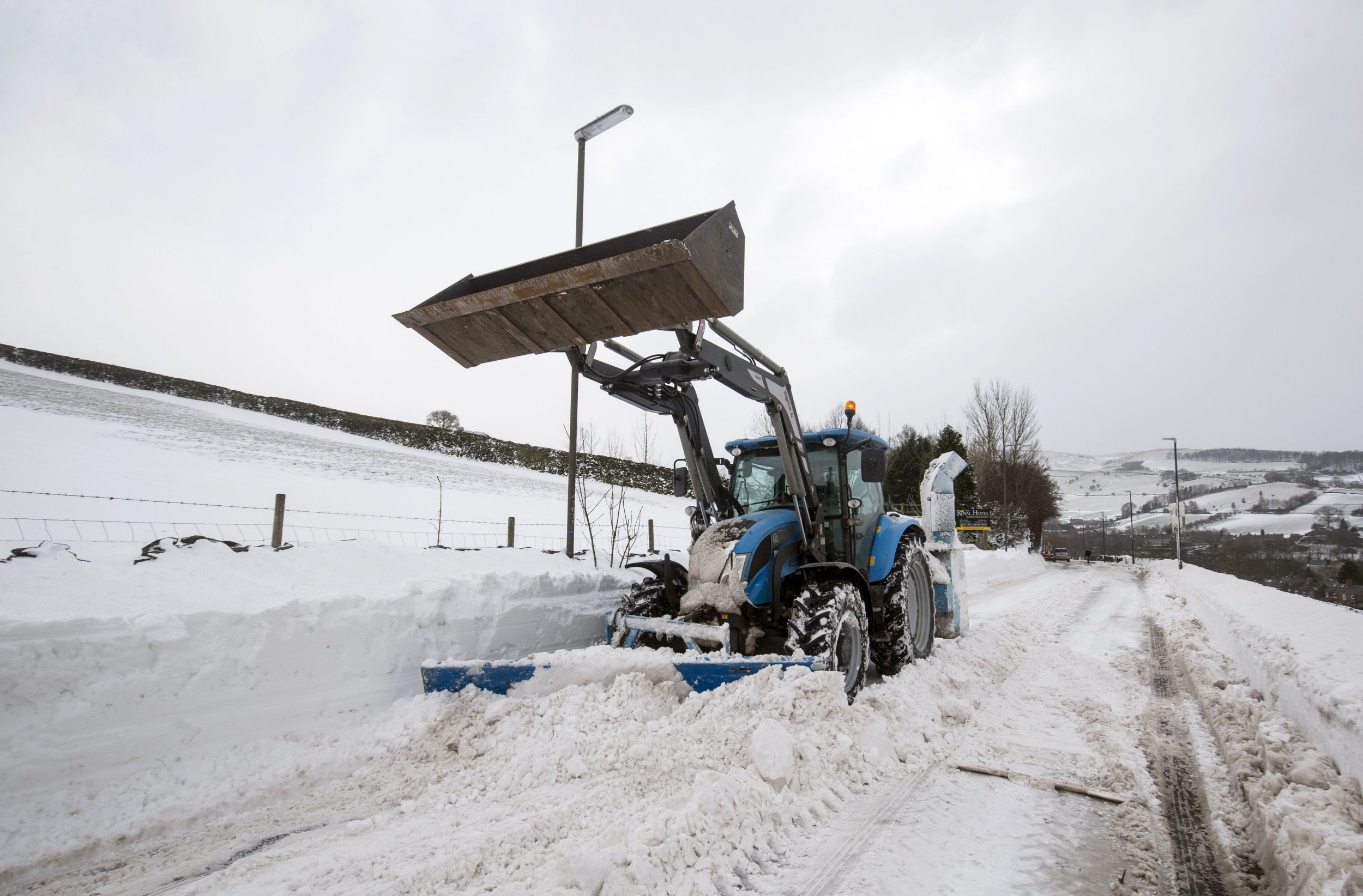"Snow is cleared from a road in Hayfield in Derbyshire as the wintry snap dubbed the ""mini beast from the east"" keeps its grip on the UK."