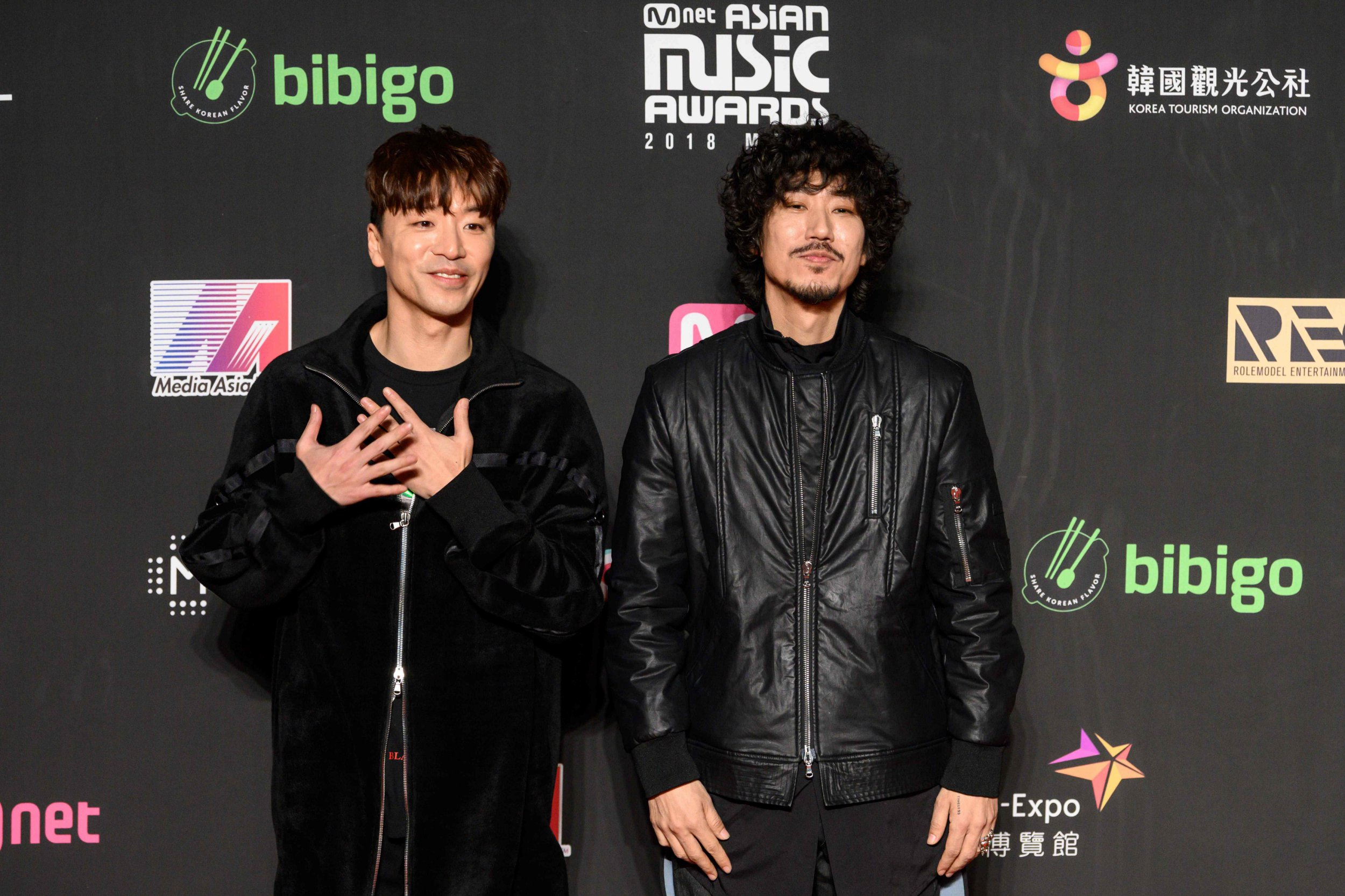 South Korean singers Bizzy (L) and Tiger JK pose on the red carpet at the Mnet Asian Music Awards (MAMA) in Hong Kong on December 14, 2018. (Photo by Anthony WALLACE / AFP)ANTHONY WALLACE/AFP/Getty Images