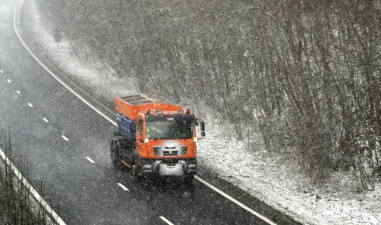 """A gritting lorry at work on the A2 near Canterbury in Kent as the cold snap dubbed the """"mini beast from the east"""" continues across the UK."""