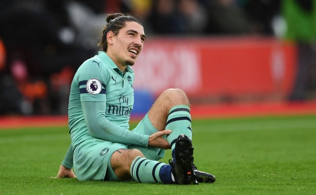 SOUTHAMPTON, ENGLAND - DECEMBER 16: Hector Bellerin of Arsenal holds his calf muscle during the Premier League match between Southampton FC and Arsenal FC at St Mary's Stadium on December 16, 2018 in Southampton, United Kingdom. (Photo by David Price/Arsenal FC via Getty Images)