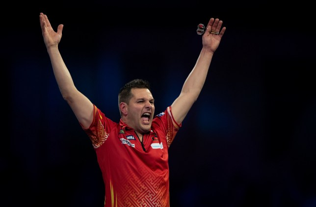 Toni Alcinas celebrates winning his match against Peter Wright during day four of the William Hill World Darts Championships at Alexandra Palace, London. PRESS ASSOCIATION Photo. Picture date: Sunday December 16, 2018. Photo credit should read: Ian Walton/PA Wire