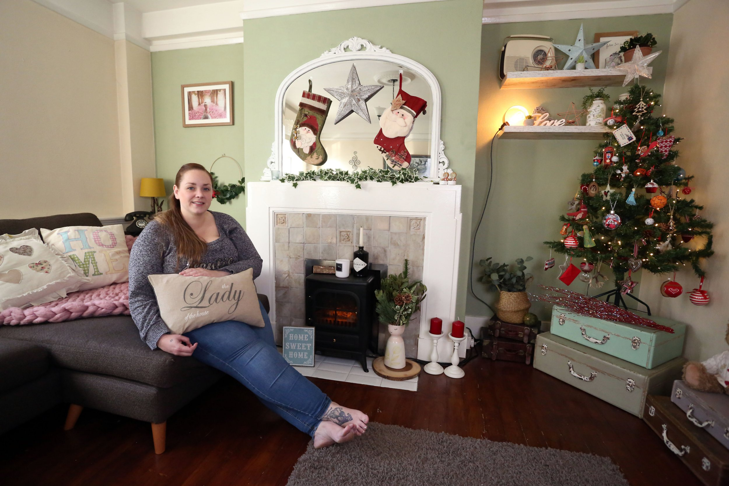 LONDON, UNITED KINGDOM, DECEMBER 17TH 2018. WHAT I RENT: STREATHAM HILL Tenant Carlie Line pictured in the living room of her two bedroomed flat in Streatham Hill, London, 17th December 2018. Carlie pays ?1500 a month not including bills. Photo credit: Susannah Ireland