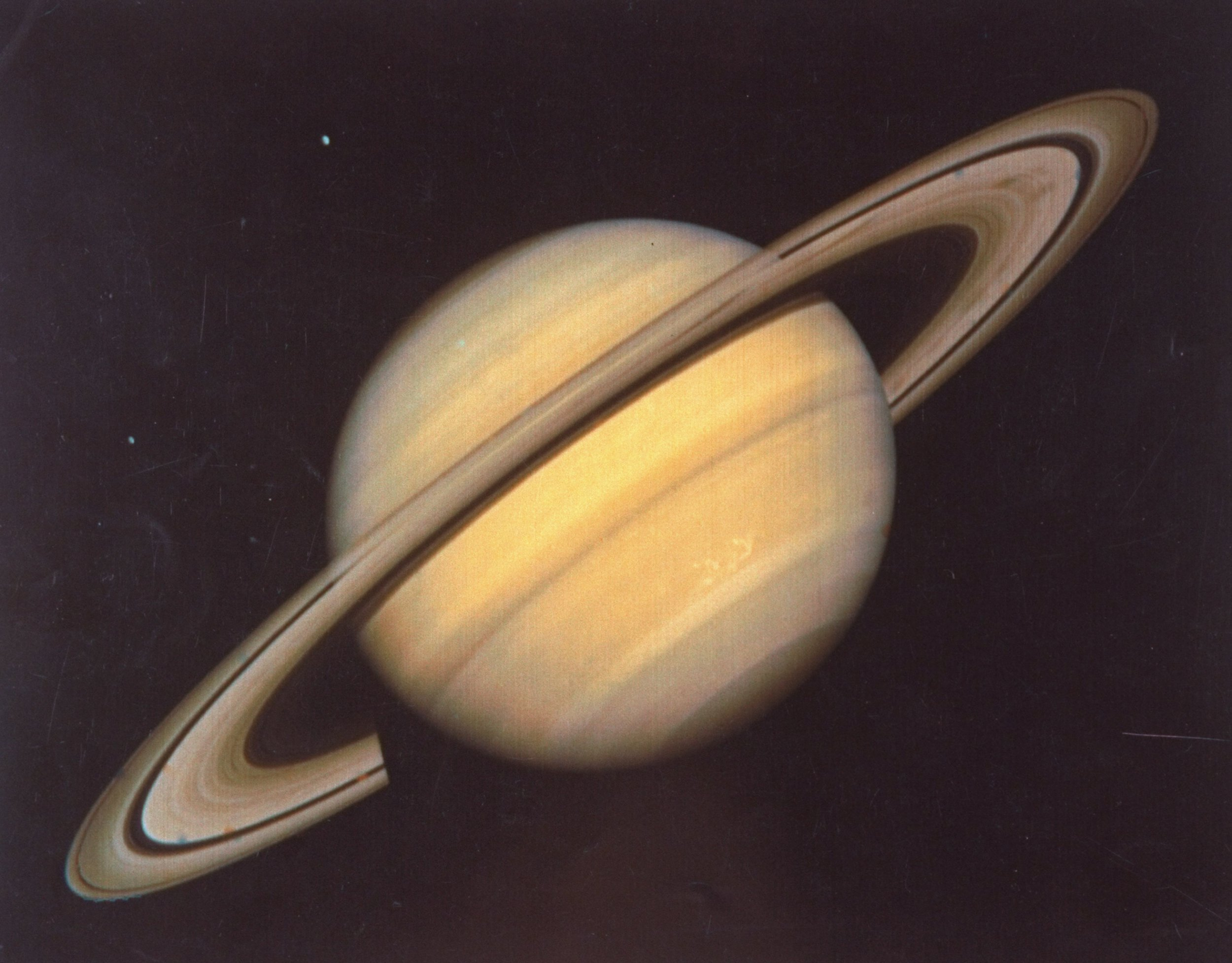 Saturn's rings are disappearing Saturn and moons Rhea and Dione taken by NASA's Voyager 2 spacecraft. (Photo by Time Life Pictures/NASA/JPL/The LIFE Picture Collection/Getty Images)