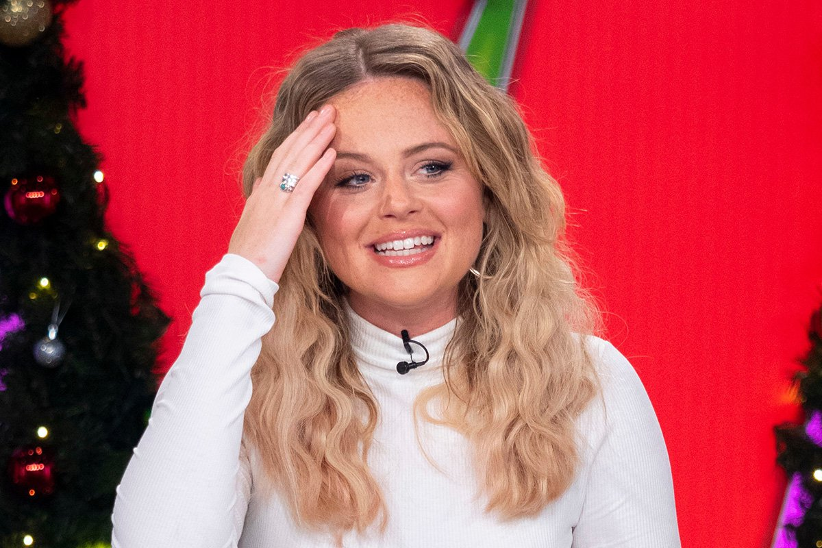 Emily Atack has been 'snogging' someone but insists she is still totally single