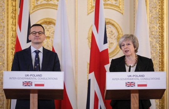 epa07242303 Polish Prime Minister Mateusz Morawiecki (L) and British Prime Minister Theresa May (R) at a press conference after their meeting at Lancaster House in London, Britain, 20 December 2018. Polish Prime Minister Morawiecki is in London for British-Polish intergovernmental consultations. The talks focus on Brexit and future cooperation within the NATO (North Atlantic Treaty Organization). EPA/PAWEL SUPERNAK POLAND OUT