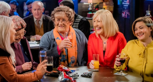 WARNING: Embargoed for publication until 00:00:01 on 11/12/2018 - Programme Name: Mrs Brown's Boys Christmas and New Year Special - TX: 25/12/2018 - Episode: n/a (No. n/a) - Picture Shows: **STRICTLY EMBARGOED NOT FOR PUBLICATION BEFORE 00:01 HRS ON TUESDAY 11TH DECEMBER 2018** Winnie McGoogan (EILISH O'CARROLL), Mrs Brown (BRENDAN O???CARROLL), Cathy Brown (JENNIFER GIBNEY), Maria Brown (FIONA O'CARROLL) - (C) BBC Studios - Photographer: Alan Peebles